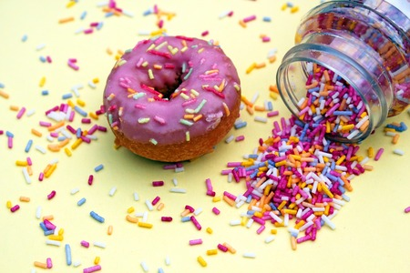 donut donuts sprinkles on doughnuts pink bright sugar strands background 100s and thousands decoration Stock Photo