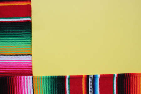poncho Mexican cinco de mayo rug serape fiesta traditional Mexico background with stripes copy space maya blanket minimal simple -  stock, photo, photograph, image, picture