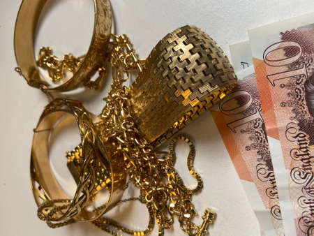 Gold scrap pile chains and bangle jewelry money in pawn shop, gold is a favorite to trade in scrap