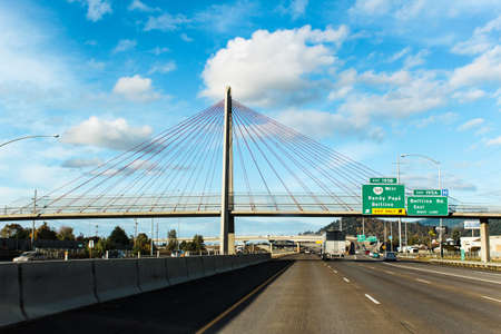 fast lane: This is a beautiful suspension bridge over Interstate 5 in Eugene, Oregon. Stock Photo