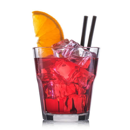 Red cocktail in old fashioned cocktail glass isolated on white background. Stock Photo