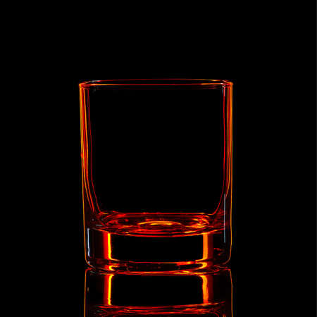 Silhouette of red strong liquor classic glass with clipping path on black background.