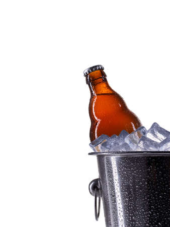 Metal champagne ice bucket with beer isolated on a white background.