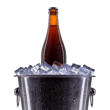 beer bucket: Metal champagne ice bucket with beer isolated on a white background.
