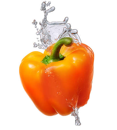 segmento: Water splash and vegetables isolated on white backgroud with clipping path. Fresh bell pepper Foto de archivo