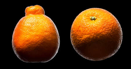 Mandarin, tangerine citrus fruit isolated on black background