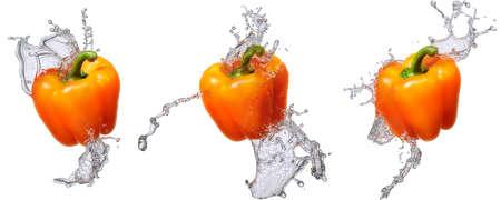 Water splash and vegetables isolated on white backgroud. Fresh bell pepper