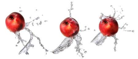 Water splash and fruits isolated on white backgroud. Fresh nectarine Stock Photo