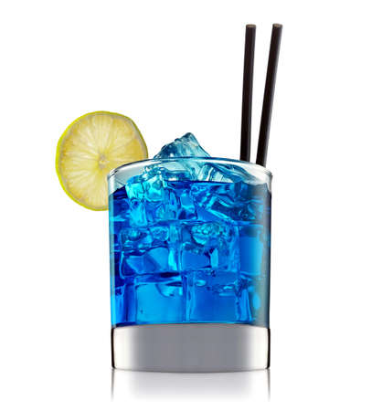 hard: fresh fruit alcohol cocktail or mocktail in classic glass with blue beverage and ice cubes isolated on white background