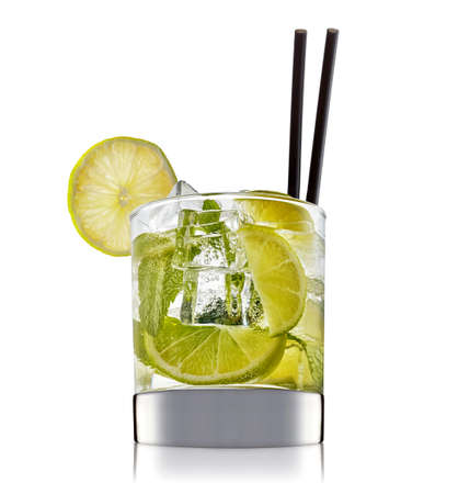 fresh fruit alcohol cocktail or mocktail in classic glass with ice cubes, lime and mint isolated on white background