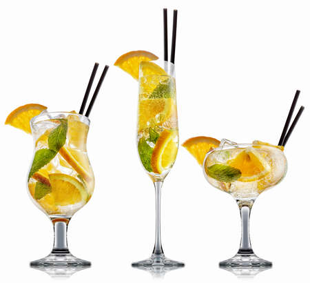 Fresh fruit alcohol cocktail or mocktail in classic glass with ice cubes, orange and mint isolated on white background Reklamní fotografie