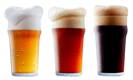 Mug collection of frosty dark red and light beer with foam isolated on a white background Stock Photo