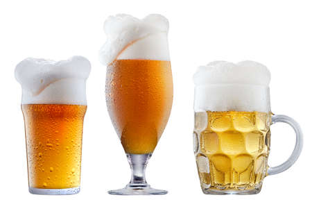 Mugs of frosty light beer with foam isolated on a white background
