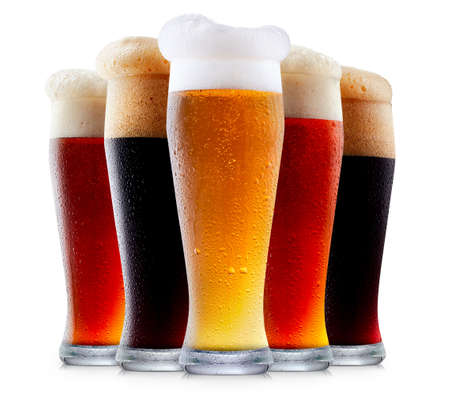 Mug collection of frosty dark red and light beer with foam isolated on a white