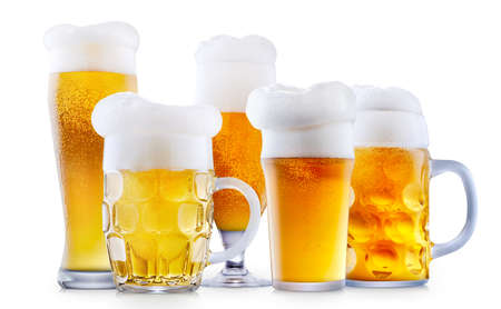 Mug of frosty light beer with foam isolated on a white