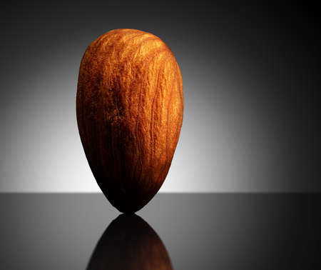 Almond on black background with reflection. Close-up or macro. Health concept