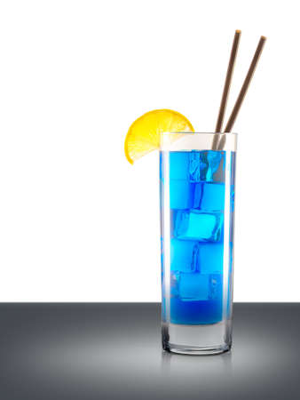 Blue curacao cocktail in classical glass with slice of lemon and tube isolated on mirror table and place for inscription. Clipping path