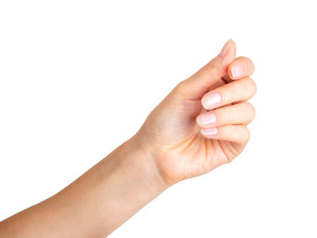 Woman hand holding something with three fingers.