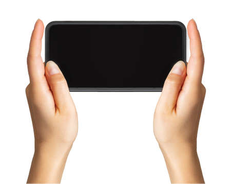 Womens hand showing black smartphone, concept of taking photo or selfie with two hands. Isolated with clipping path.