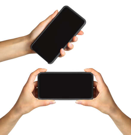Set of womens hands showing black smartphone, concept of taking photo or selfie. Isolated with clipping path.