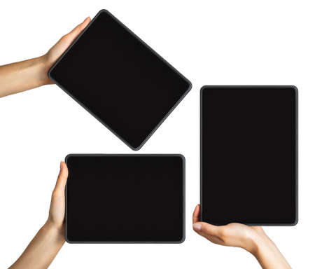 Mock up of black tablets and womens hands, concept of mobile shopping. Isolated with clipping path. Imagens