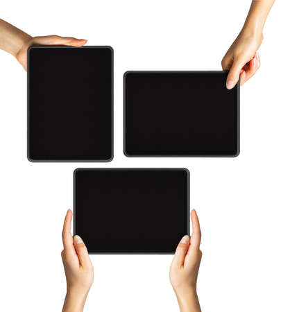 Set of womens hands showing black tablets, concept of taking photo or playing games with two hands. Isolated with clipping path.