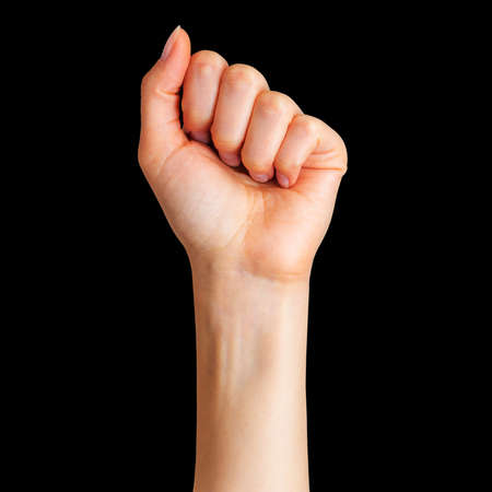 Woman clenched fist  Concept of unity, revolution or fight on