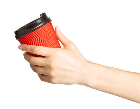Woman hand holding coffee paper drinking cup with disposable top cap on white