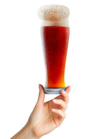 Woman hand holding mug of beer with foam on white background. Isolated with clipping path. Imagens - 126528085