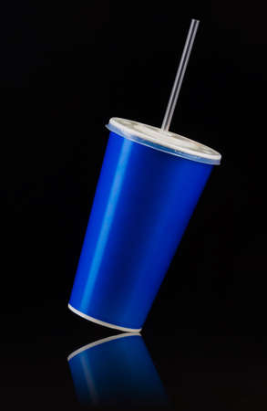 Blue cup with cap and tube isolated on black
