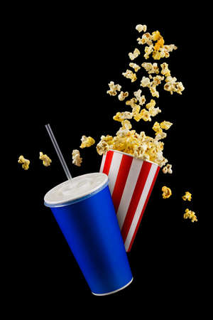 Set of paper striped bucket with popcorn and cup of soft drink isolated on black background, movie night concepto or watching TV.