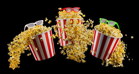 Set of bucket with popcorn and 3D glasses isolated on black background, concept of watching TV or cinema. 写真素材