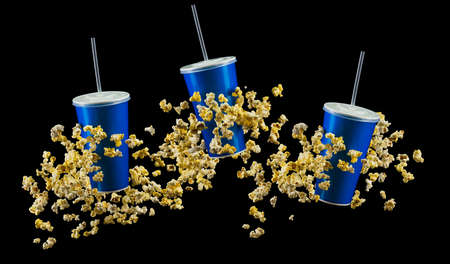 Set of blue cups and popcorn isolated on black background. Concept of refreshments in cinema or watching movies