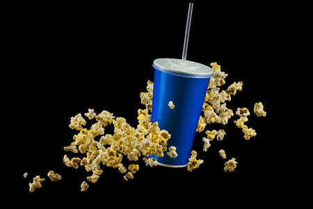 Blue cup with cap and flying popcorn isolated on black background. Concept of refreshments in cinema or watching movies