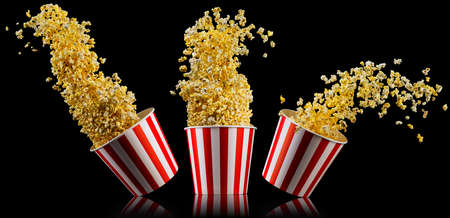 Set of paper striped buckets with popcorn isolated on black background, concept of watching TV or cinema.