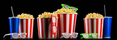Set of striped buckets with popcorn, cups of drink and glasses isolated on black background, movie night concepto or watching TV. 版權商用圖片