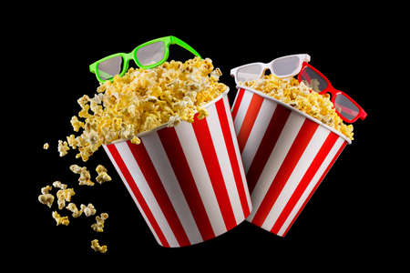 Set of buckets with popcorn and 3D glasses isolated on black background, concept of watching TV or cinema. 版權商用圖片