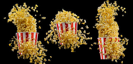 Set of paper striped buckets with popcorn isolated on black Stock Photo