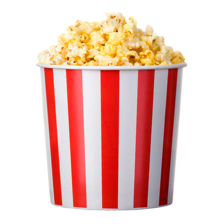Paper striped bucket with popcorn isolated on white background with clipping path. Concept of cinema or watching TV.