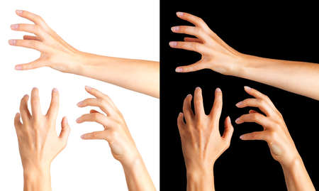 Woman hands with crooked fingers showing magic trick or holding ball on black and white