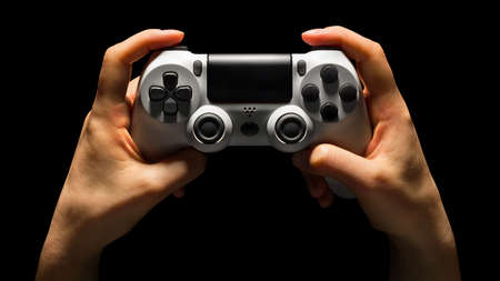 Hyman hands video game joystick gamepad isolated on a black