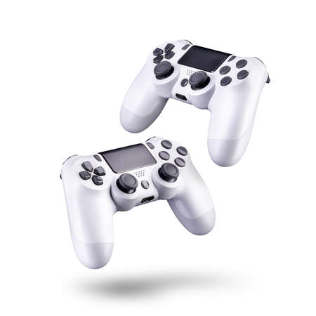Set of white video game joysticks gamepad isolated on a white background, concept of playing games or watching TV.