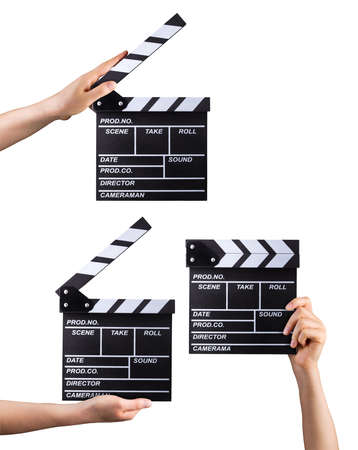 Set of film clapper boards and human hands isolated on white background.