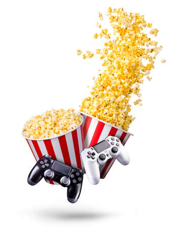 Flying popcorn and video game joystick gamepad isolated on a white background.