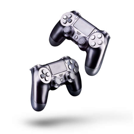 Set of black video game joysticks gamepad isolated on a white background, concept of playing games or watching TV.
