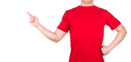 Man in red t-shirt pointing arm and fingers on the side isolated white background with clipping path. Concept of t shirt template or delivery