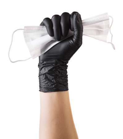 Hand in black gloves hold disposable face mask isolated on white background  . Concept of medical and healthcare