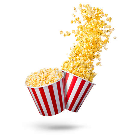 Set of flying popcorn from paper striped buckets isolated on white background. Concept of cinema or watching TV.
