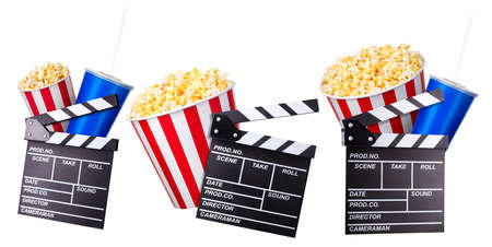 Flying popcorn and film clapper board isolated on white background, concept of watching TV or cinema. 版權商用圖片