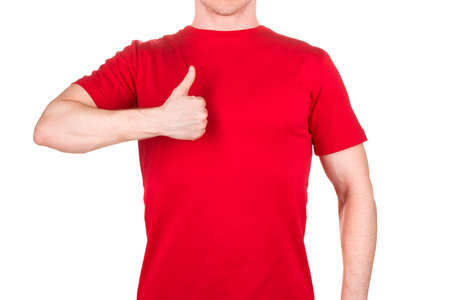 Front view of confident male in red t-shirt showing thumbs up gesture isolated white background  . Concept of t shirt template and mock-up for print